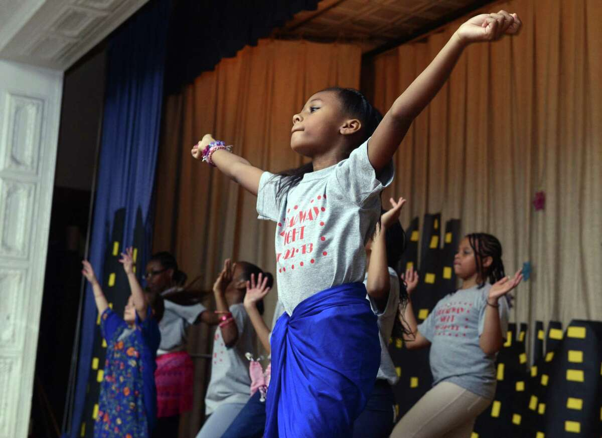 Fourth grade student Naomi Maxwell dances during a Bollywood version of