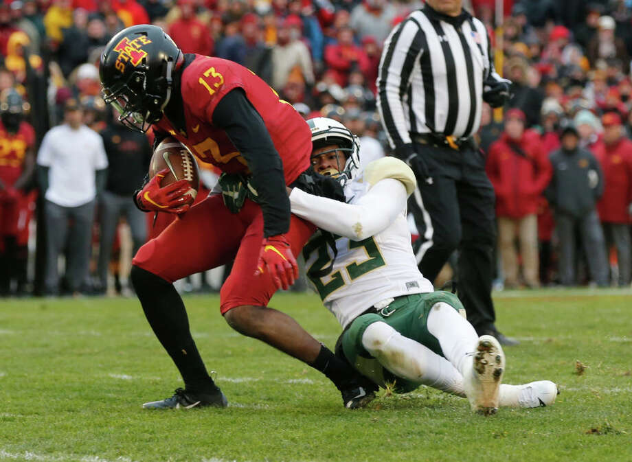 PHOTOS: New Era's official 2019 NFL Draft caps  AMES, IA - NOVEMBER 10: Cornerback Derrek Thomas #23 of the Baylor Bears tackles wide receiver Josh Johnson #13 of the Iowa State Cyclones as he rushed for yards in the first half of play at Jack Trice Stadium on November 10, 2018 in Ames, Iowa. The Iowa State Cyclones won 28-14 over the Baylor Bears. (Photo by David K Purdy/Getty Images) >>>See the caps that will be worn by players at the 2019 NFL Draft ...  Photo: David K Purdy/Getty Images / 2018 David K Purdy