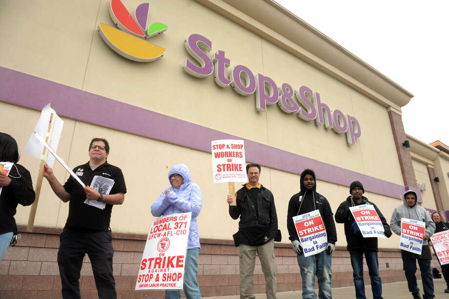Workers walk the picket line in front of the Stop & Shop on Fairfield Ave., in Bridgeport, Conn. April 11, 2019. Stop & Shop employees across Connecticut and New England walked out on strike Thursday after failing to resolve a contract impasse. Photo: Ned Gerard, Hearst Connecticut Media / Connecticut Post
