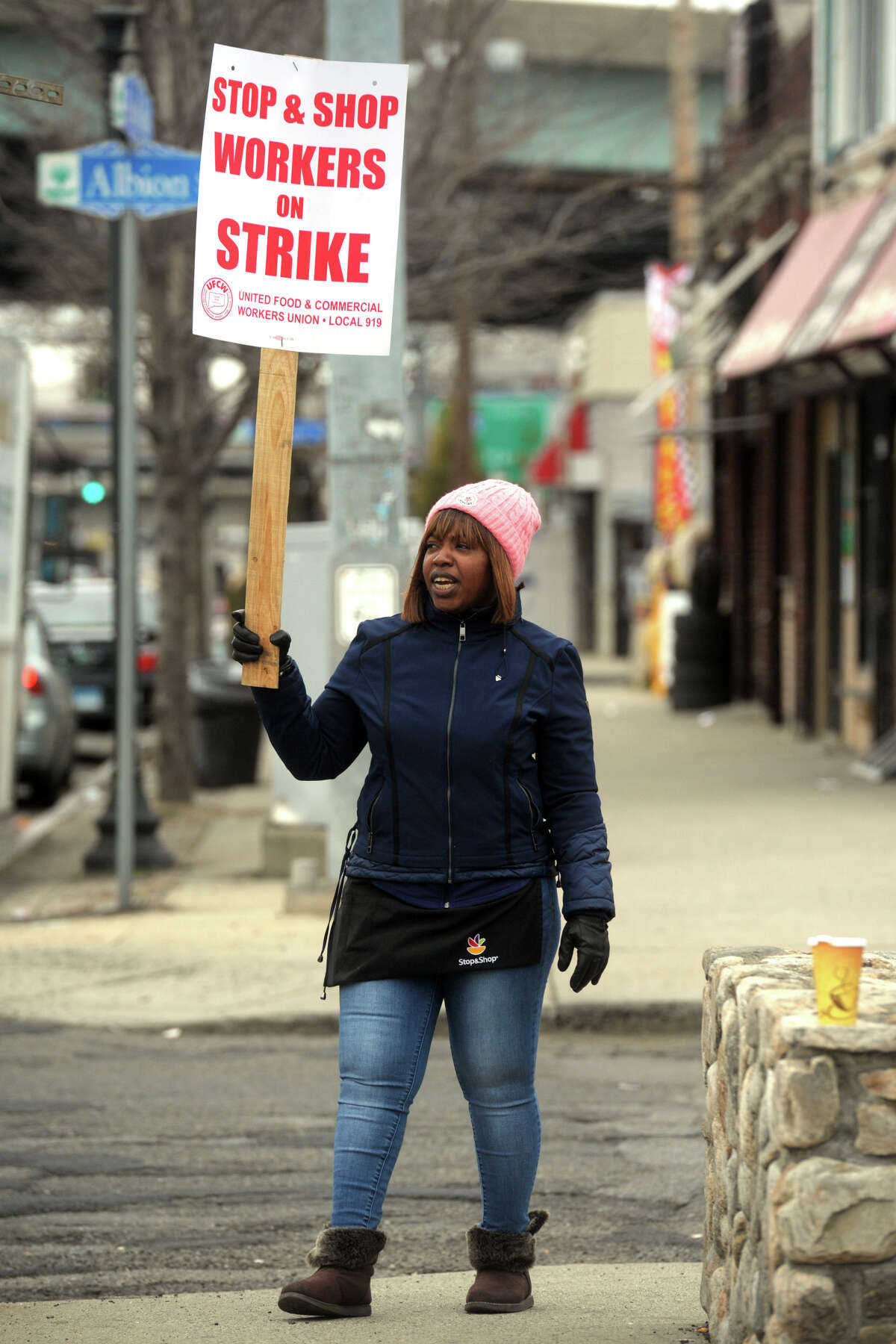 Reasheba McGhie, a pricing clerk at the Stop & Shop on Fairfield Ave., in Bridgeport, Conn. pickets in front of the store after she and her fellow union workers walked out on strike April 11, 2019. Stop & Shop employees across Connecticut and New England walked out on strike Thursday after failing to resolve a contract impasse.