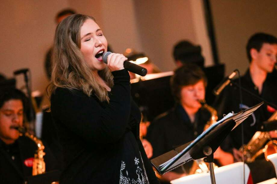 Conroe sophomore Meredith Fisk sings with The Jazz Connection during Conroe Symphony Orchestra's 20th anniversary All That Jazz Gala on Saturday, April 29, 2017, at the North Montgomery County Community Center in Willis. The Jazz Connection awarded a scholarship to vocalist Meredith Fisk, graduating senior from Conroe High School. With The Jazz for two years, she also appears onstage in Conroe theatres. Photo: Michael Minasi, Staff Photographer / Houston Chronicle / Stratford Booster Club