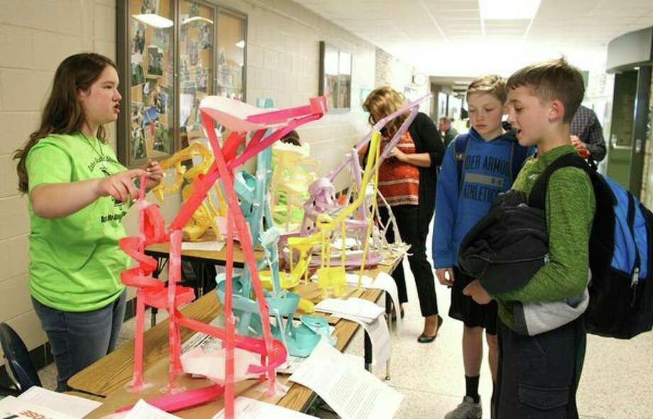 Laker student Grace McArdle talks with Jayce Sears and Jack Turner about the seventh grade marble runs created in science class. The marble runs were presented as part of the Student Project Showcase April 4 at Laker Secondary School. The showcase featured many examples of project-based learning. (Submitted Photo)