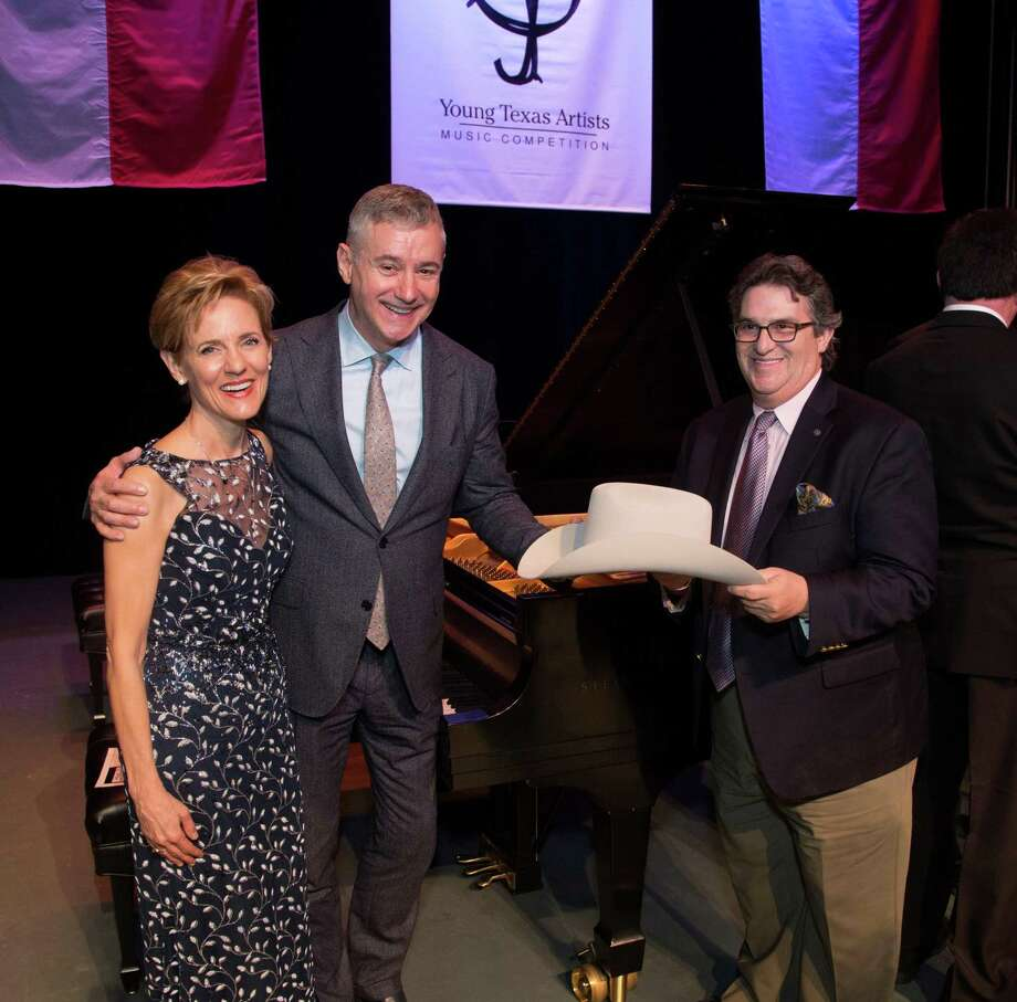 "Guest of Honor Ron Losby (center), CEO of Steinway & Sons, accepts ""The YTA Stetson Hat Award"" from YTA President/CEO Susie Pokorski and Danny Saliba, owner Steinway Piano Gallery of Houston and Steinway Hall-Dallas/Fort Worth/Plano. Photo: Photo By Brad Meyer"