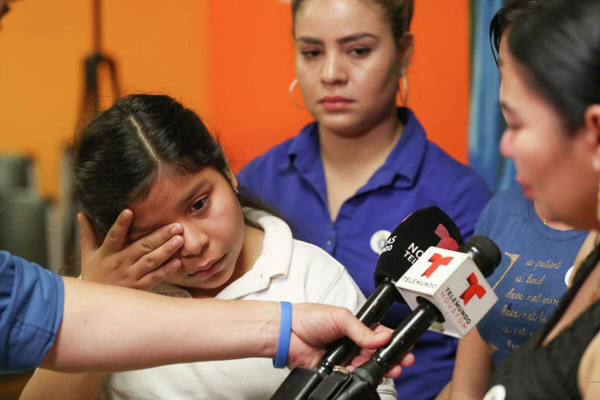 Laura Maradiaga,11, becomes emotional as her family talk about her possible deportation back to El Salvador Thursday, April 11, 2019, in Houston.