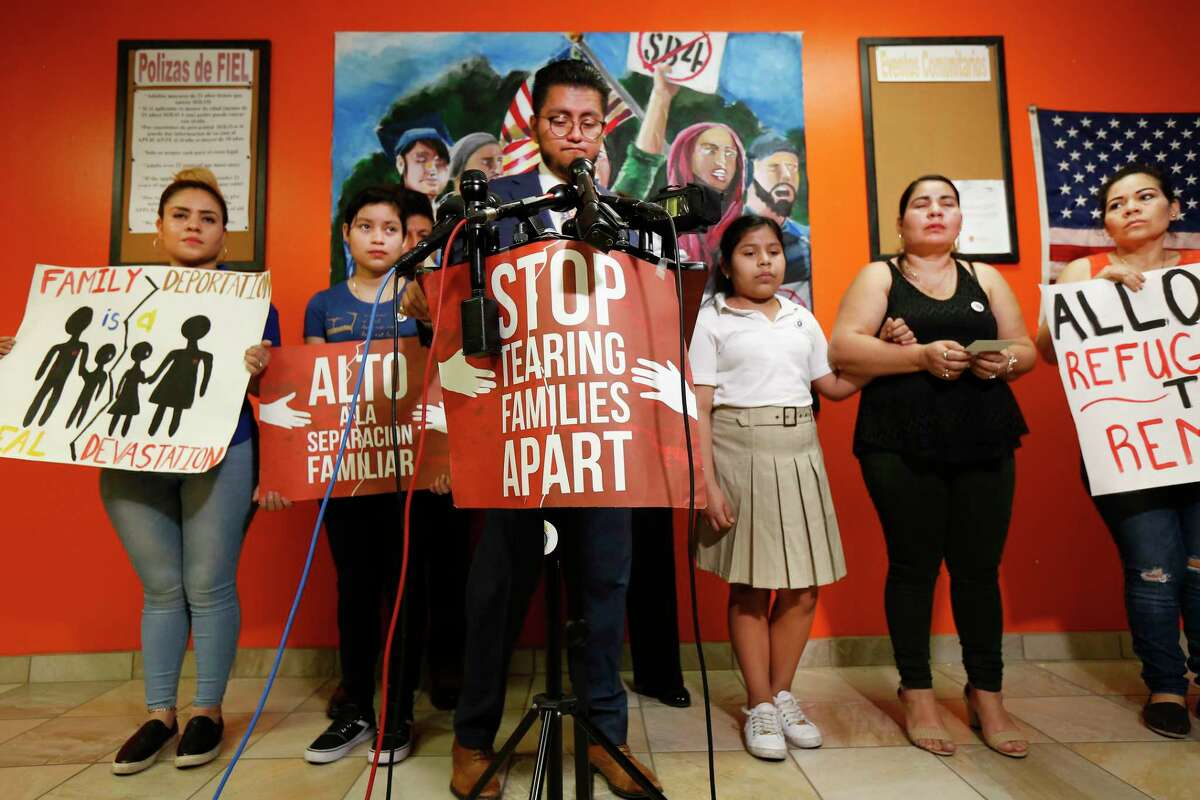 Cesar Espinosa (center), Executive Director at FIEL Houston Inc. talks about Laura Maradiaga,(3rd from right)11, who is facing deportation back to El Salvador Thursday, April 11, 2019, in Houston. Left-right, Laura's sisters, Katherine Maradiaga, 21, Adamaris Alvardo,15, Doris Avardo (mom) and her aunt.