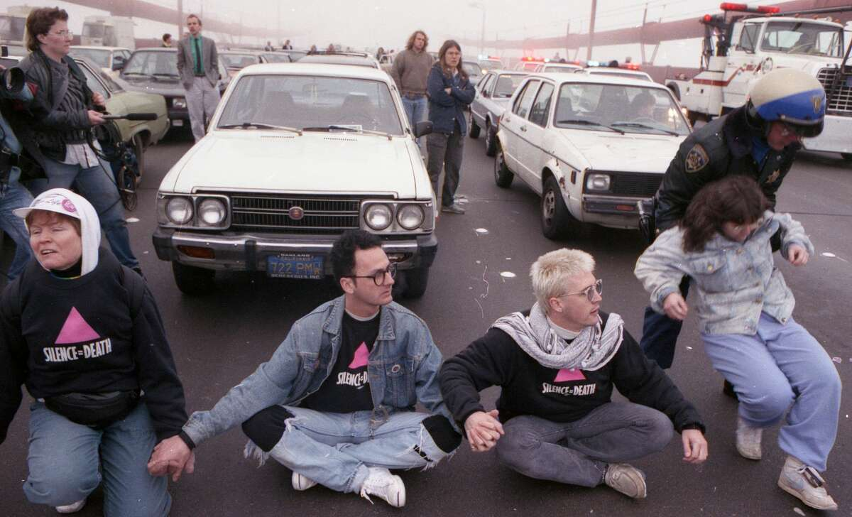 This photo of Stop AIDS Now or Else (SANOE) protesters blocking the Golden Gate Bridge in 1989 is one that will be featured in the