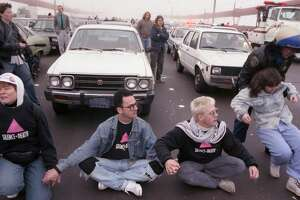 "This photo of Stop AIDS Now or Else (SANOE) protesters blocking the Golden Gate Bridge in 1989 is one that will be featured in the ""Queer California: Untold Stories"" exhibit at OMCA."