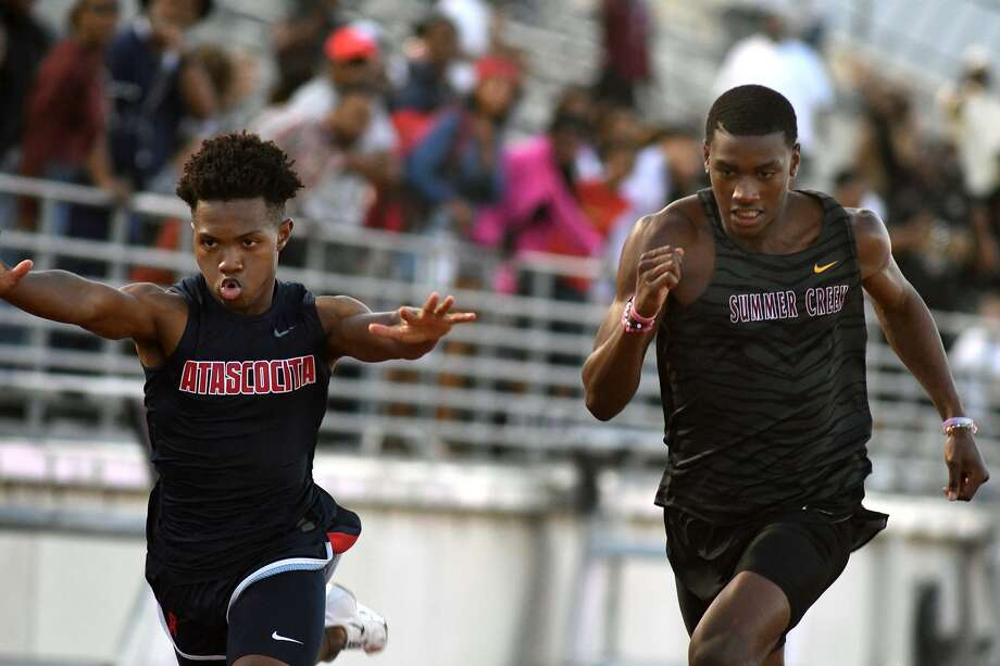 Atascocita's Trevion McCalla, left, and Summer Creek's De'Vion Hargrove battle to the finish line in the Boys 200 Meter Dash at the 22-6A District Track Meet at Turner Stadium in Humble on April 10, 2019. Photo: Jerry Baker, Houston Chronicle / Contributor / Houston Chronicle