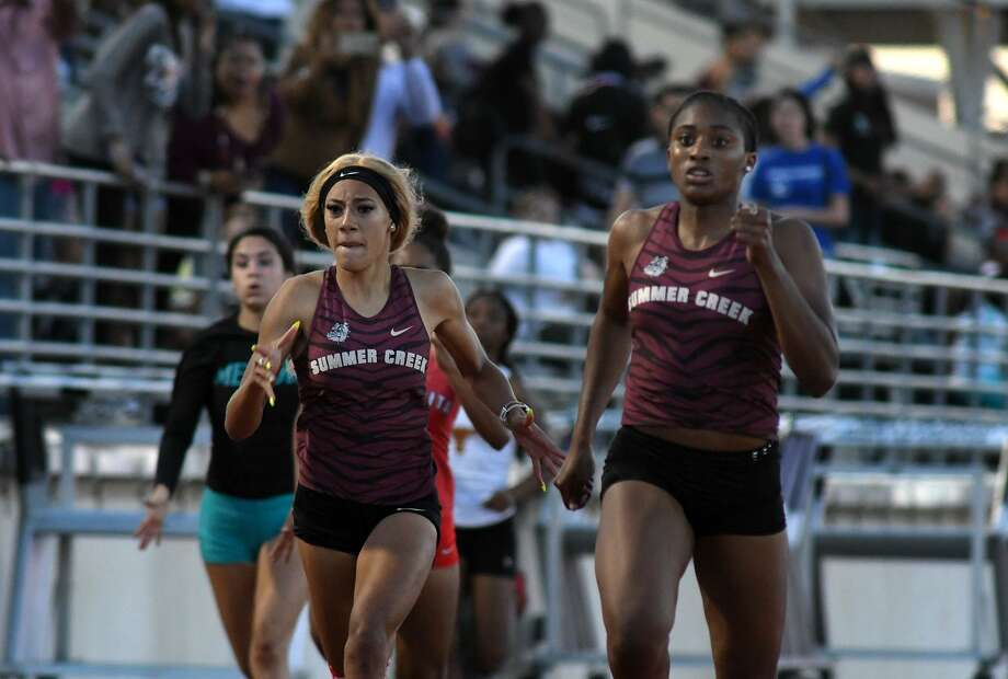 Summer Creek's Tianna Randle, from left, and teammate Dynasty McClennon battle to the finish line in the Girls 200 Meter Dash at the 22-6A District Track Meet at Turner Stadium in Humble on April 10, 2019. Photo: Jerry Baker, Houston Chronicle / Contributor / Houston Chronicle