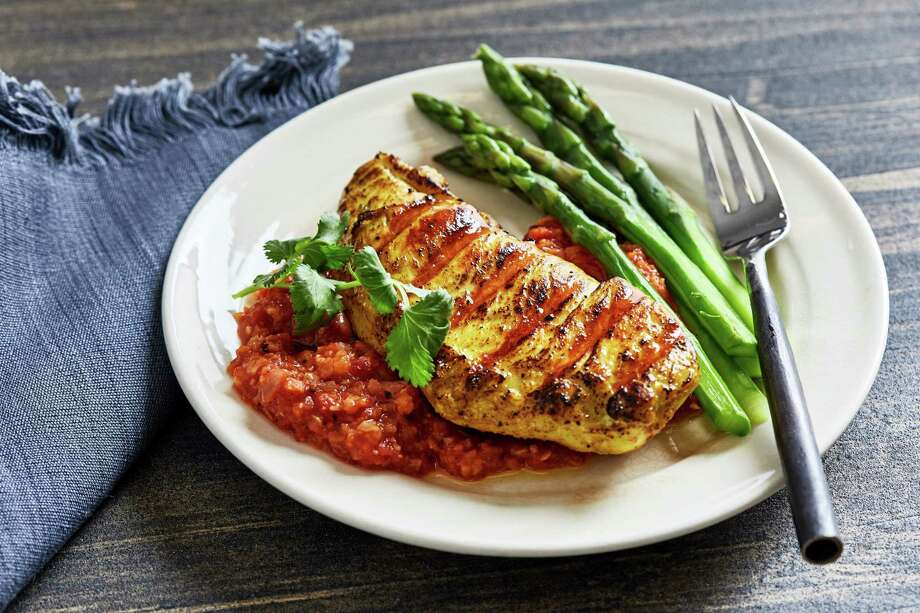 Golden Grilled Chicken With Tomato-Peanut Chutney. Photo: Photo By Stacy Zarin Goldberg For The Washington Post; Food Styling By Lisa Cherkasky For The Washington Post. / For The Washington Post