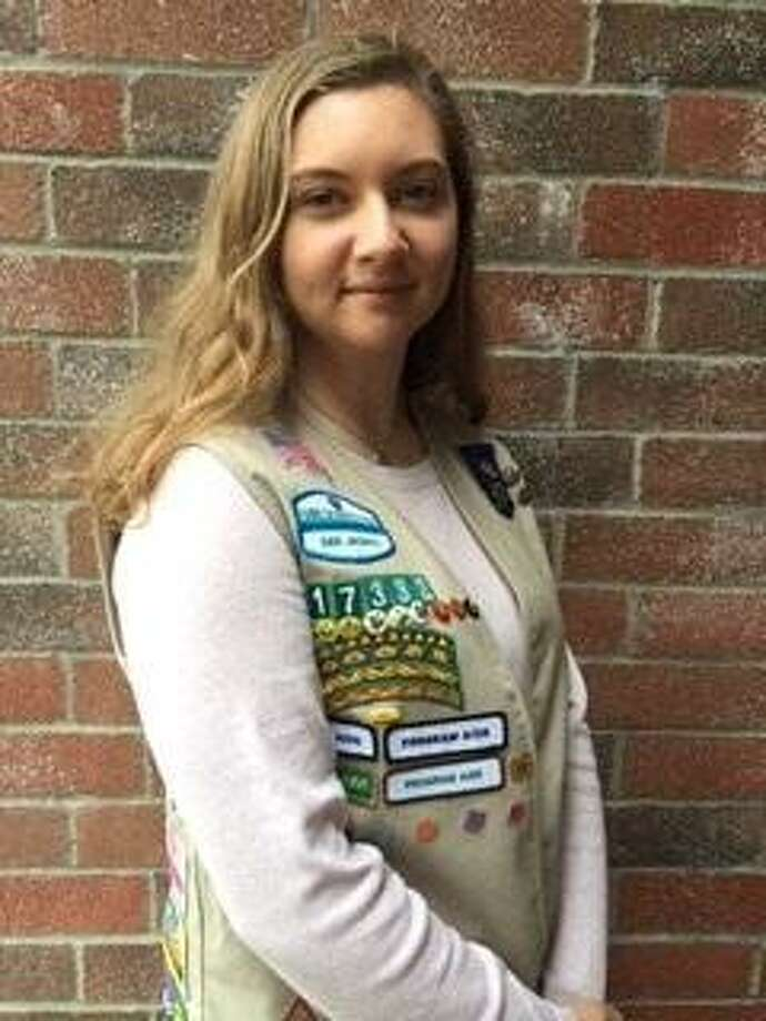 Gretchen Plocek, a Patricia E. Paetow High School junior, has become a Gold Award Girl Scout. Plocek created a prayer resource to teach the importance of the practice. Plocek held prayer sessions to teach through Sunday school and Bible studies why praying is important. Photo: Courtesy Photo