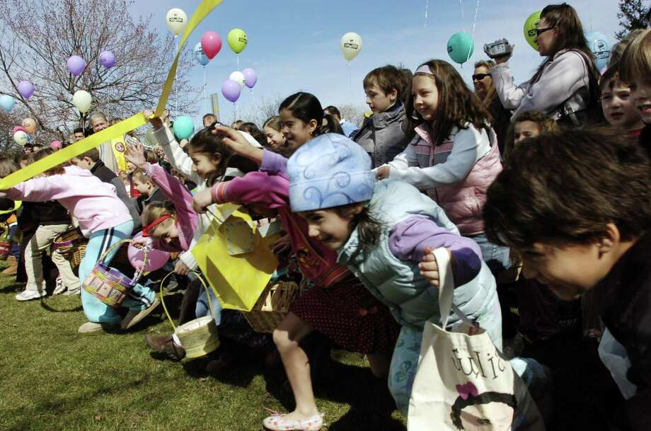 Youngsters take off at the start of a previous annual Egg Hunt at Roger Sherman Baldwin Park in Greenwich. The event returns April 13. Photo: Hearst Connecticut Media File Photo / Hey Bob, I just talked to Jesse,