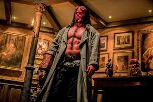 """This image released by Lionsgate shows David Harbour in a scene from """"Hellboy."""" (Mark Rogers/Lionsgate via AP)"""