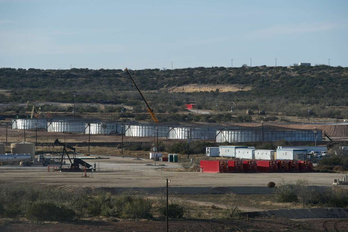 Houston-based Apache Corp. employs re-engineered grain bins to treat produced water which emerges from wells along with oil and gas -- before recycling it for use in hydraulic fracturing of Wolfcamp Shale wells in the Barnhart area in Irion County, Texas.