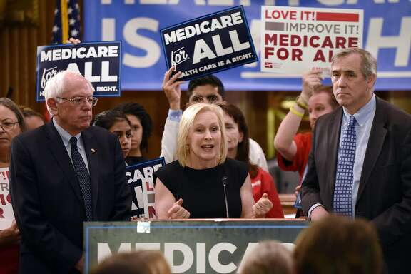 New York senator and 2020 candidate Kirsten Gillibrand speaks as Senator Bernie Sanders, left, looks on during an event to introduce the Medicare for All Act of 2019 on Capitol Hill on April 10, 2019 in Washington, D.C. (Olivier Douliery/Abaca Press/TNS)