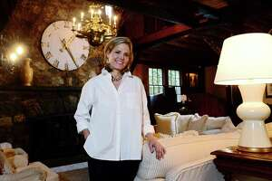 Jennifer O'Brien at her home at 2 Bayberry Lane in Westport. The house, built in 1835 by the Jennings family, originally comprised a master bedroom, a bathroom, a horse and onion barn, a hayloft and a chicken coup. It now comprises more than 5,000 square feet, has a three-story stone fireplace, eight bedrooms, and an in-law suite.