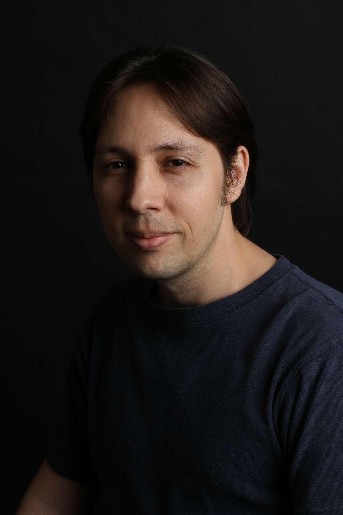 A portrait of linguist David J. Peterson.