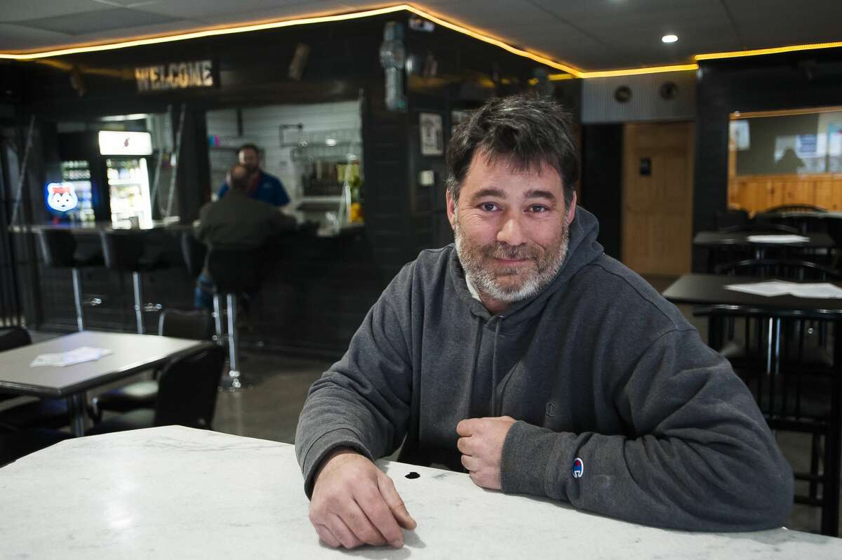 Joe Lancaster, owner of Eighteen Taps LLC, poses for a portrait on Thursday, April 11, 2019 inside the brand new craft beer tap room located at 3340 M-18 in Beaverton. For more photos, go to www.ourmidland.com. (Katy Kildee/kkildee@mdn.net)