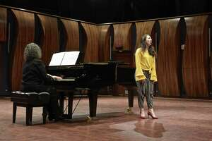 "Soprano Alexandra Dima sings ""Out of the South Blew a Wind"" by Florence Price, accompanied by Yale University Music Lecturer Sara Kohane, during the Western Connecticut State University's School of Visual and Performing Arts Marian Anderson Tribute Concert. WCSU vocal students performed songs by four leading African American female composers to celebrate the 80th anniversary of Anderson's concert on the steps of the Lincoln Memorial in 1939. In Veronica Hagman Concert Hall. Tuesday, April 9, 2019, in Danbury, Conn."