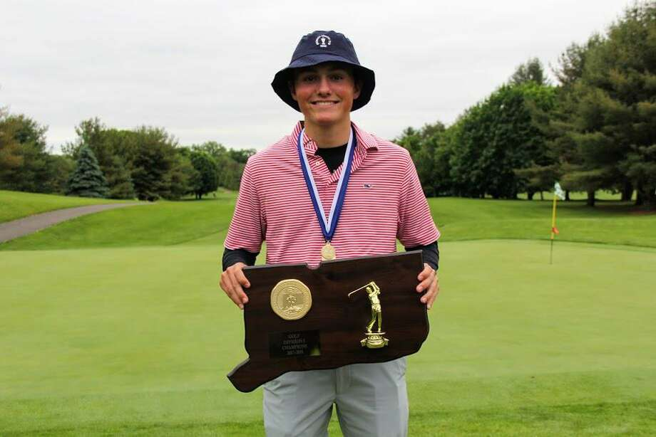 Jackson Fretty holds the championship trophy after the Greenwich High School boys golf team won the CIAC Division I title last season at Stanley Golf Club in New Britain. Fretty earned medalist honors at the tournament with a 3-under-par 68 Photo: Contributed Photo / Stamford Advocate Contributed