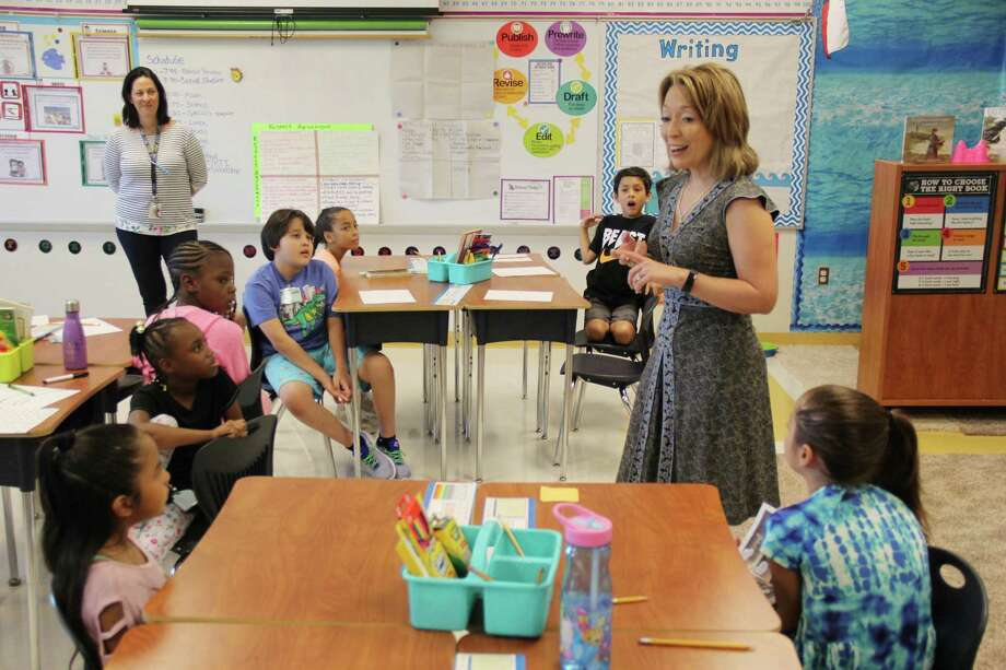 Judson ISD Superintendent Jeanette Ball talks with middle school students in September while making the rounds through the district during the first week of school. The Judson school district is having board elections. Photo: David Rhoads / Judson ISD /