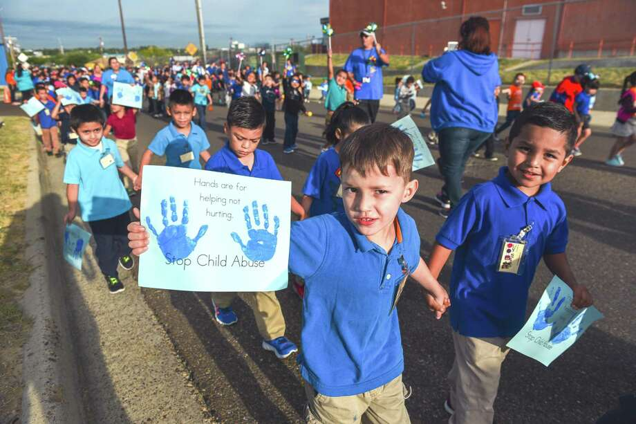 Students from Kawas Elementary marched down San Luis Street holding up signs to raise awareness for child abuse prevention, April 7, 2017. April is National Child Abuse Prevention Month. Photo: Danny Zaragoza /Laredo Morning Times / Laredo Morning Times