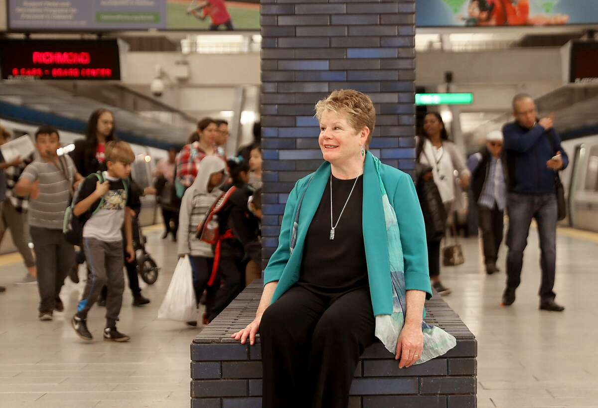 BART General Manager Grace Crunican watches passengers at the 19th Street station on Friday, Nov. 2, 2018, in Oakland, Calif.