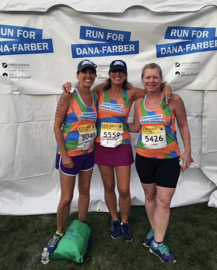 From left to right, Pamela Karpen, her sister, Deborah Sloan, and their friend, Lisa Singer. Written on their arms are the names of family and friends who had cancer that the trio runs for. Photo: Contributed Photo / Stamford Advocate Contributed