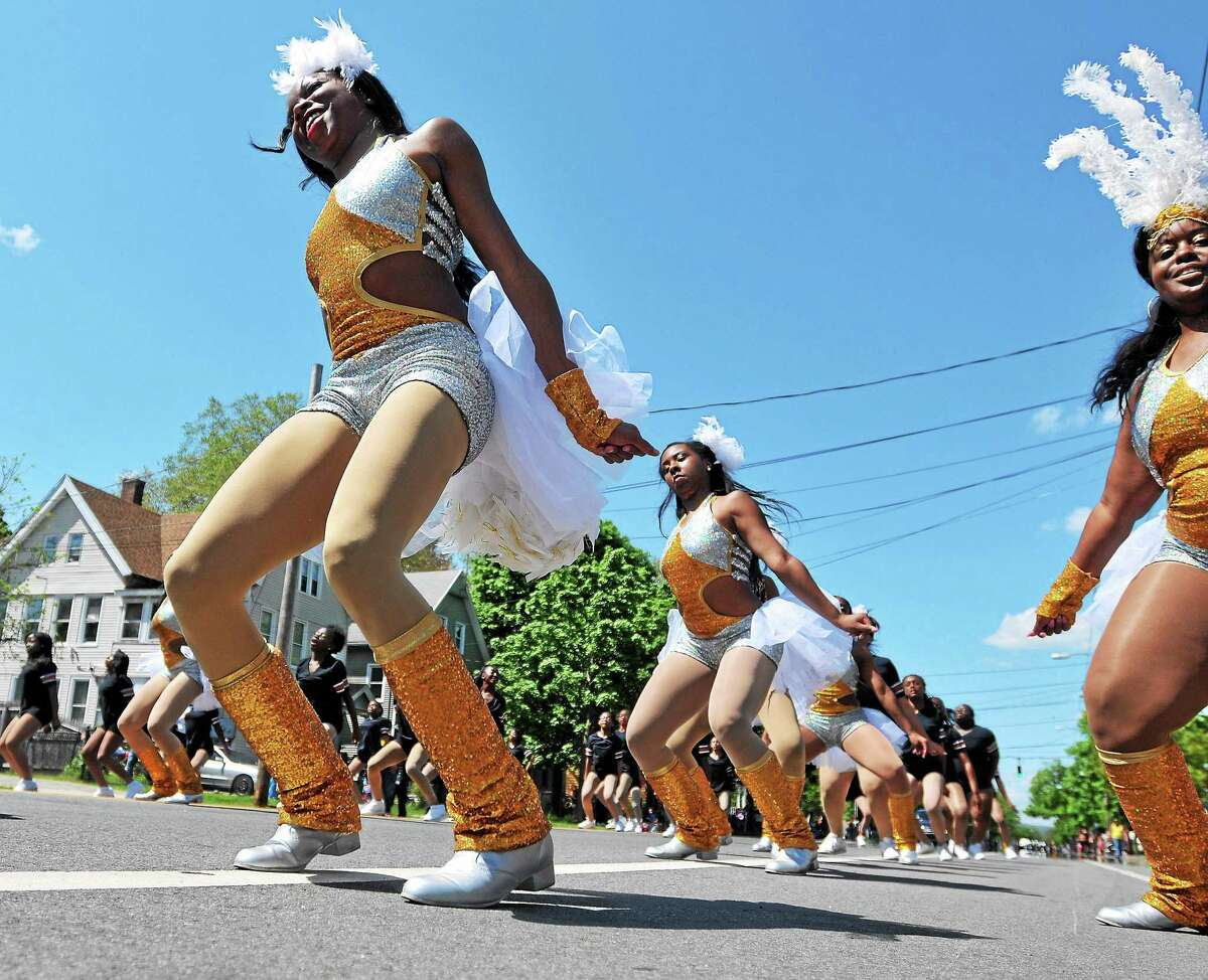 Members of the Hamden Academy of Dance put on a show along Dixwell Avenue in New Haven during the 2014 Freddie Fixer Parade.