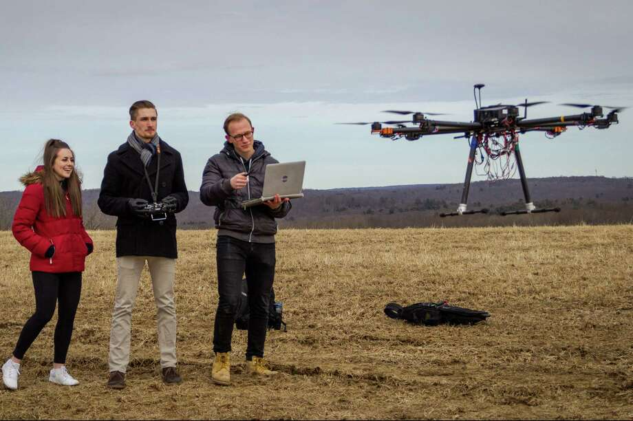 Left to right, UConn students Kerry Jones, Ryan Heilemann, and Josh Steil have developed and programmed a drone that can fight fires as part of a Engineering Senior Design projects sponsored by Sikorsky. Photo: Contributed Photo / Contributed Photo / Connecticut Post Contributed