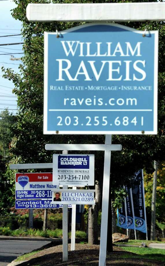 A file photo of real estate signs on North Ave. in Bridgeport, Conn., with the state's largest city seeing a 22 percent increase in home sales in the first quarter of 2019, even as New Haven and Stamford registered big declines. Photo: Cathy Zuraw / Cathy Zuraw / Connecticut Post