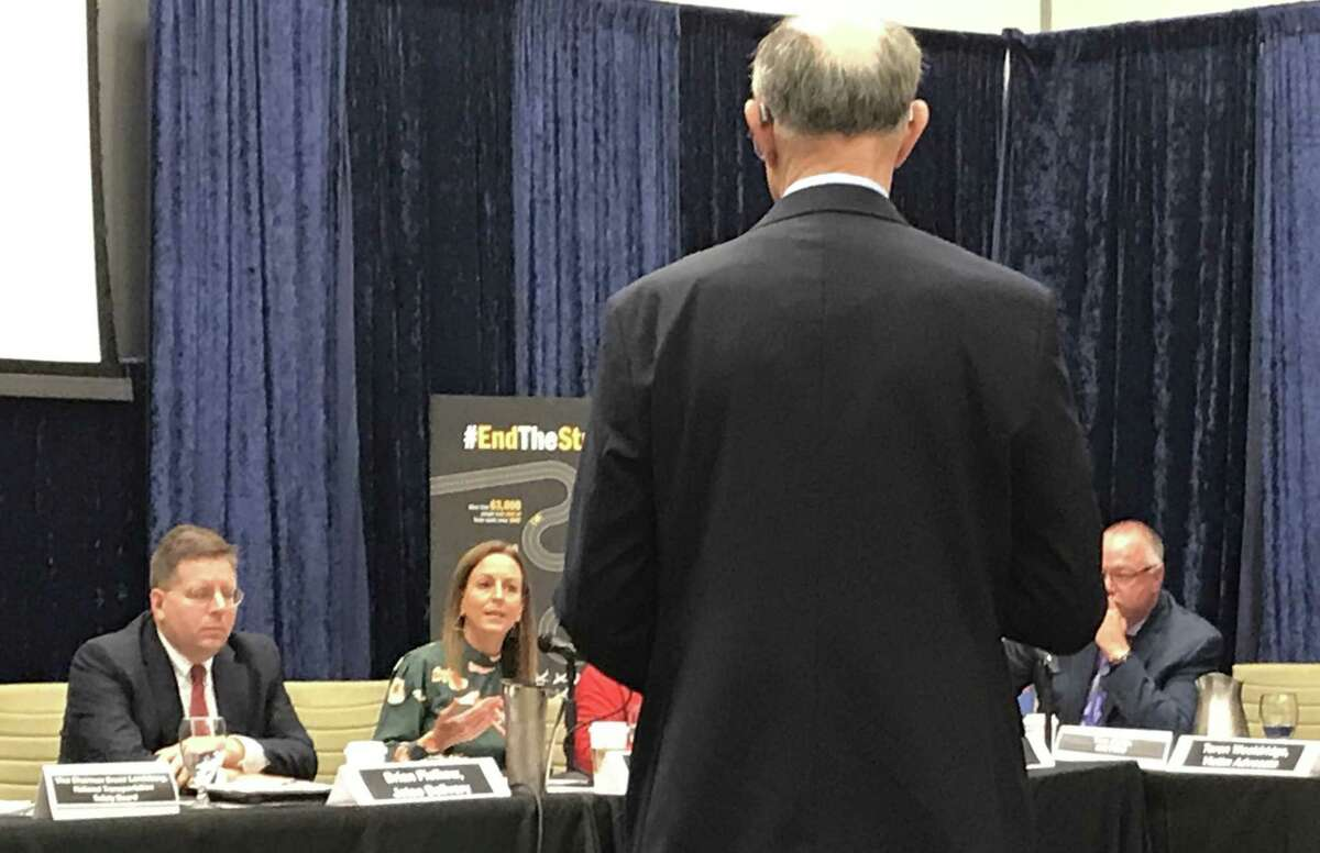Jennifer Smith, executive director of stopdistractions.org, an advocacy group, speaks to National Transportation Safety Board vice-chairman Bruce Landsberg, foreground, during a NTSB roundtable on dangerous driving, held in Houston on Thursday.
