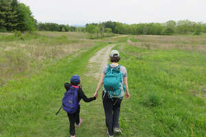 Outdoors writer Gillian Scott with her daughter in the spring of 2016. (Herb Terns / Times Union)