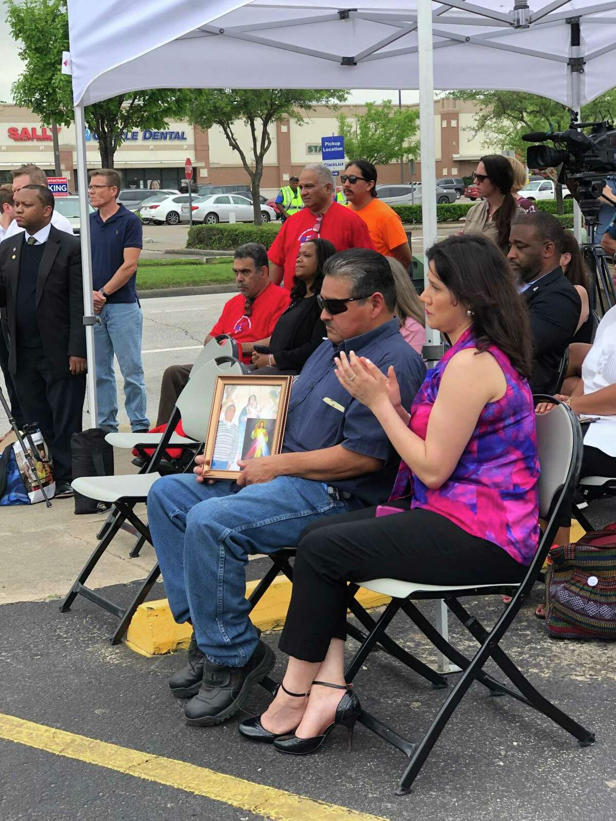 Dennis Perez holds a picture of his late brother, Jesus Perez, at a press conference on pedestrian safety improvements held by Houston Mayor Sylvester Turner on April 11, 2019. Perez, 63, and Lesha Adams, 55, were fatally struck by a car while crossing a busy street in the Greater Heights last month. Adams had stopped her SUV to help the wheelchair-bound Perez cross busy N. Shepherd Street.