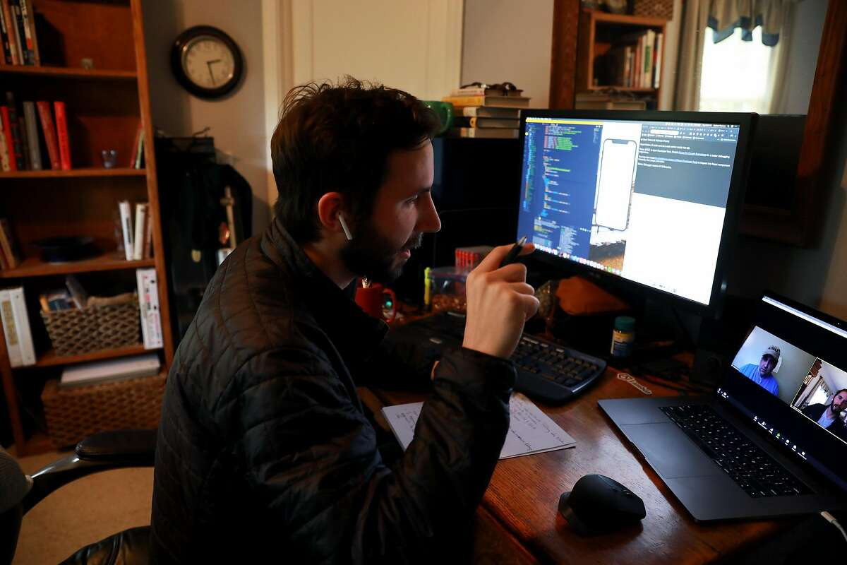 Nathan Thomas, a student at Lambda School - a coding academy - has a video chat with Bryon Holmes, a fellow student and project manager who also works with other students, as he works from his bedroom in Angwin, Calif., on Tuesday, April 2, 2019. Lambda doesn't charge any upfront tuition. Instead students pay 17% of their income for two years after graduation. Thomas is currently working for them as a Section Lead, overseeing 18 project managers.