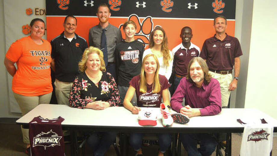 Edwardsville senior Elise Krone, seated middle, signed to compete in track and field and cross country at Cumberland University. She is joined by her family and EHS and Cumberland coaches. Photo: Scott Marion/Intelligencer