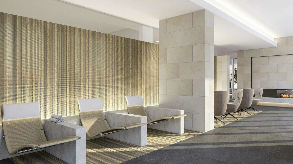 Lobby/parlor seating is very modern, and a front desk is wrapped in stainless steel to help animate that space at the La Colombe d'Or Hotel and Residences under construction on Montrose Boulevard.