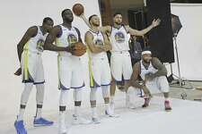 Golden State Warriors' Kevin Durant, from left, Draymond Green, Stephen Curry, Klay Thompson and DeMarcus Cousins poses for photos for the team's photographer during media day at the NBA basketball team's practice facility in Oakland, Calif., Monday, Sept. 24, 2018.