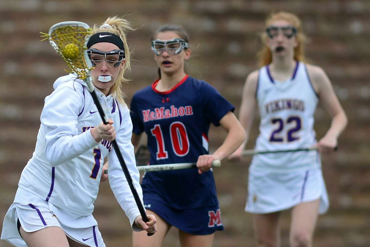 Viking #1 Emily Reid keeps the ball away from the defense as the McMahon High School Senators take on the Westhill High School Vikings in their FCIAC girls lacrosse game Thursday, April 11, 2019, in Stamford, Conn.
