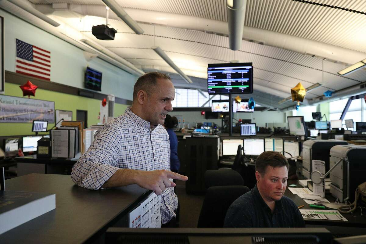 Josu Garmendia (l to r), dispatch center day shift coordinator, works with Max Repka (right), lead dispatcher as Garamendia trains Repka to be a supervisor in the dispatch center at the San Francisco Department of Emergency Management on Wednesday, April 10, 2019 in San Francisco, Calif.