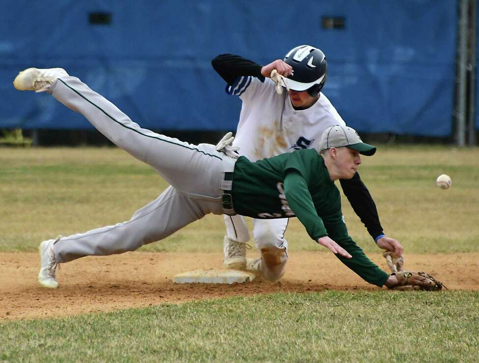 Saratoga Springs Nate Chudy steals second base as second baseman Chase Carroll dives for the throw during a baseball game on Thursday, April 11, 2019 in Saratoga Springs, N.Y. (Lori Van Buren/Times Union)