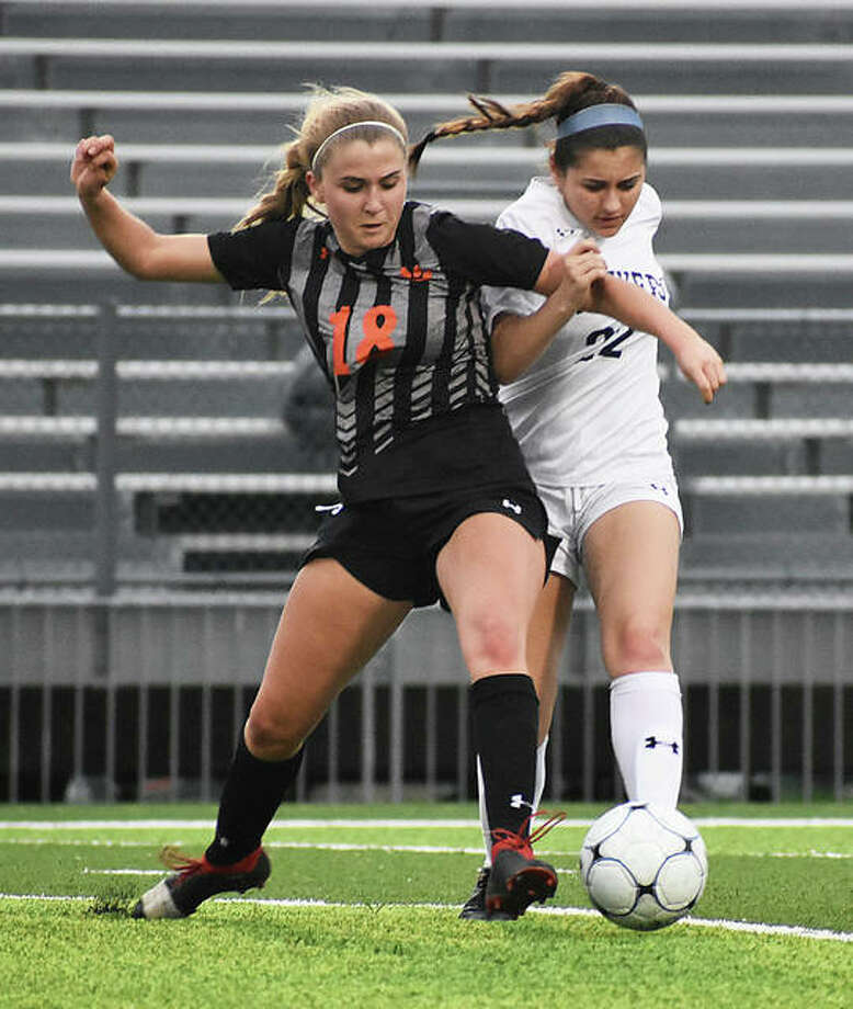 Edwardsville's Zoe Ahlers battles for possession of the ball midway through the second half against O'Fallon on Thursday inside the District 7 Sports Complex in Edwardsville.