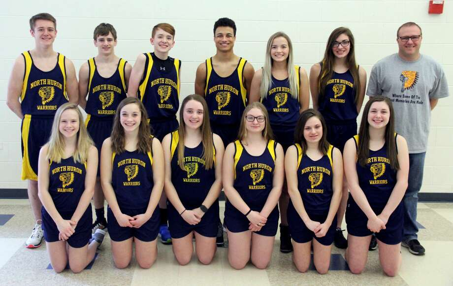 Members of the North Huron track team are (front row from left) Shelby Knoblock, Lucy Wiley, Tegan Kozlowski, Sierra Schumacher, Ellie Bender, Brooke Gordon (back row) Blake King, Ty Woodke, Maxwell Iseler, De'Andre Morris, Grace Wiley, Kylee Richmond and coach Chad Knoblock. Photo: Mike Gallagher/Huron Daily Tribune
