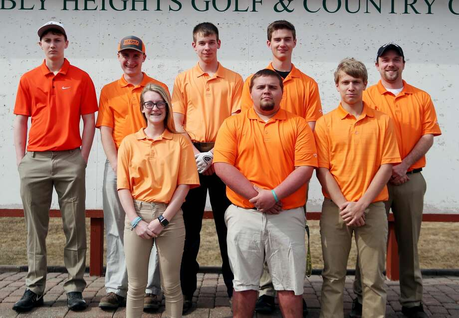 Members of the Ubly golf team are (front row from left) Jaiden Schulte, Nathan Particka and Nicholas Wright (back row) Blake Badger, Eli Emming, Zachary Ziehm, Isaac Warczinsky and coach David Hanson.  Ubly Golf Jaiden Schulte Nathan Particka Nicholas Wright Blake Badger Eli Emming Zachary Ziehm Isaac Warczinsky Head Coach David Hanson  Schedule April 22 Brown City Jamboree April 25 Ubly Jamboree April 26 Ubly Invitational April 29 Harbor Beach Jamboree May 2 Sandusky Jamboree May 6 Capac Jamboree May 15 Brown City Invitational May 20 GTC League Tournament at Scenic Golf & Country Club p.p1 {margin: 0.0px 0.0px 0.0px 0.0px; font: 18.0px Helvetica} p.p2 {margin: 0.0px 0.0px 0.0px 0.0px; font: 18.0px Helvetica; min-height: 22.0px} May 31 Regional at Verona Hills Golf Club Photo: Paul P. Adams/Huron Daily Tribune