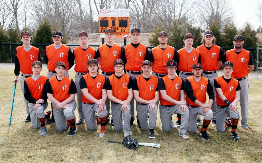 Members of the Ubly varsity baseball team are (front row from left) Dawson Schumacher, Bryce Essenmacher, Nolan VanErp, Ethan Lemke, Ryche Roggenbuck, Casey Sweeney, Tyler Jones and Andrew Becker (back row) coach Daniel Tuper, Griffin Peruski, Kyle Sweeney, Logan Hulburt, Carter Hughes, Ethan Smalley, Austin Cregeur, coach Lucas Rothe and coach Jim Becker.