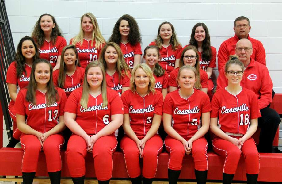 Members of the Caseville varsity softball team are (front row from left) Emma Hopkins, Natalie Campis, Dezera Breismiester, Kaylin Ewald, Alissa Logsdon (middle row) Jessica Nugent, Nicole Dufty, Tyonna Outiveros, Adrian Ewald, Chelsey Breismiester, assistant coach John Atwell (back row) Ashlee Guigar, Katelyn McCormick, Chentel Hill, Paige Samborski, Isabelle Baker and head coach Ken Ewald.