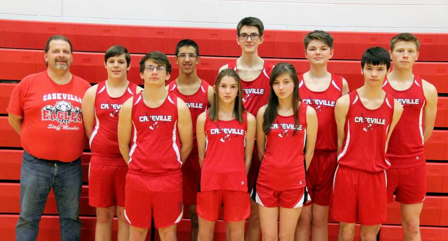 Members of the Caseville track team are (front row from left) Chance Shippey Kenzie Maust, Rylee Martin, Matthew Kennedy (back row) head coach Dru Leppek, Andrew Bond, Pinkney Barrios, Brodey Miller, Garrett Miller and Jacob Speare.  Caseville Girls Track Kenzie Maust Rylee Martin  Caseville Boys Track Chance Shippey Matthew Kennedy Andrew Bond Pinkney Barrios Brodey Miller Garrett Miller Jacob Speare  Coach Dru Leppek Photo: Mike Gallagher/Huron Daily Tribune