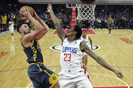 Golden State Warriors guard Klay Thompson, left, shoots as Los Angeles Clippers guard Lou Williams defends during the second half of an NBA basketball game, Monday, Nov. 12, 2018, in Los Angeles. The Clippers won 121-116 in overtime.