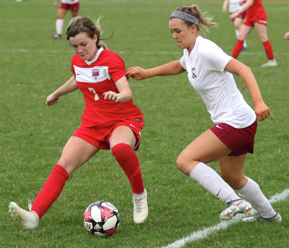 Alton's Grace Nasello (left) possesses the ball against pressure from Belleville West's Katelyn Grandcolas during the second half Thursday at Piasa Motor Fuels Field in Godfrey. Photo: Greg Shashack / The Telegraph