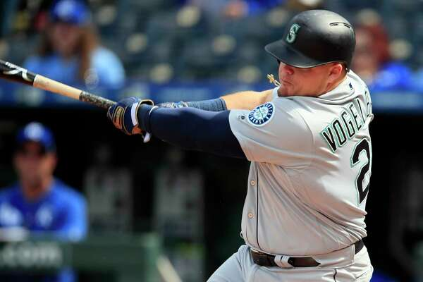 Seattle Mariners designated hitter Daniel Vogelbach hits a solo home run during the 10th inning of a baseball game against the Kansas City Royals at Kauffman Stadium in Kansas City, Mo., Thursday, April 11, 2019. The Mariners defeated the Royals 7-6 in 10 innings. (AP Photo/Orlin Wagner)